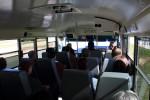 メディアのバスで移動。ラウンチパッドから離れました。こみこみ。